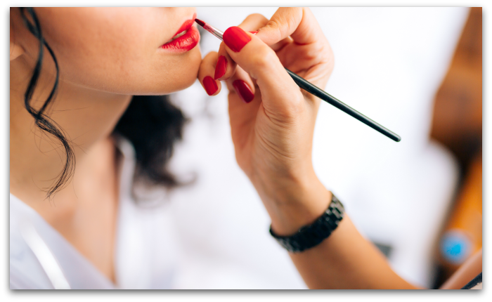 Woman training in her online makeup artistry course