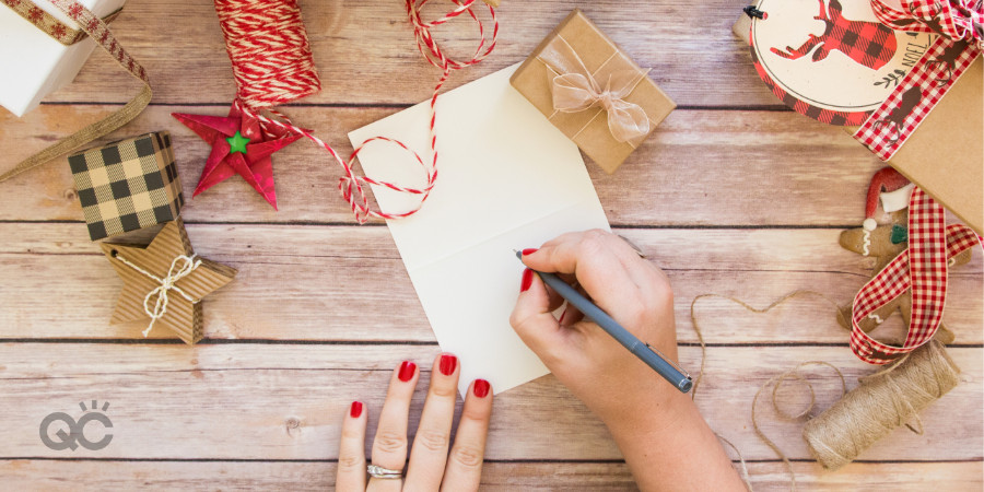 makeup artist writing a christmas card to her clients for the holidays