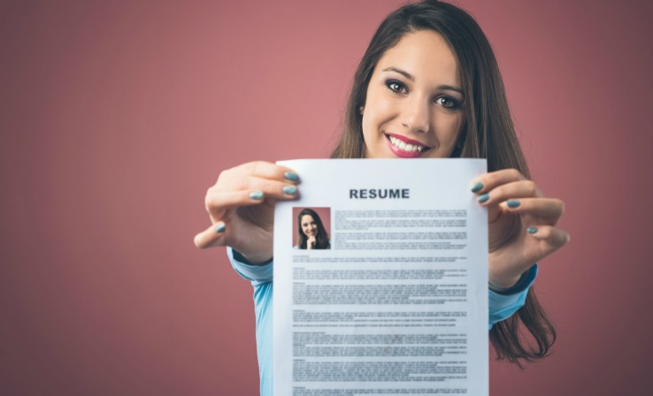 Woman holding professional resume