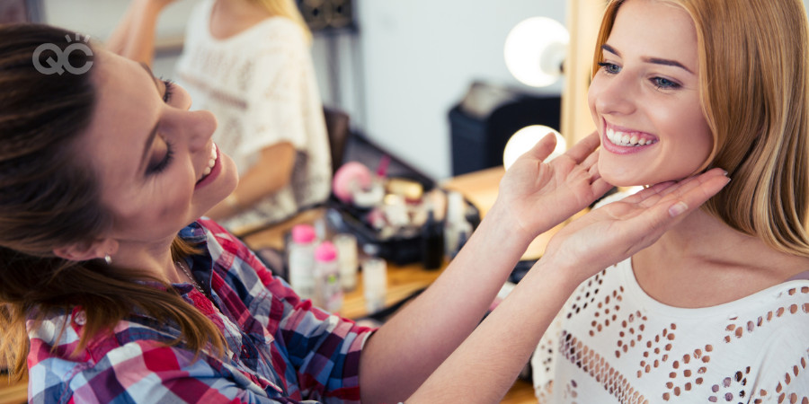 Makeup artist with her makeup client happy after an appointment