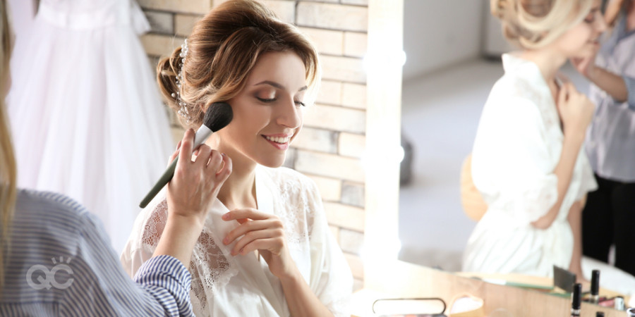 certified makeup artist applying blush to bridal client