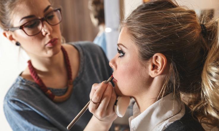 Woman practicing makeup