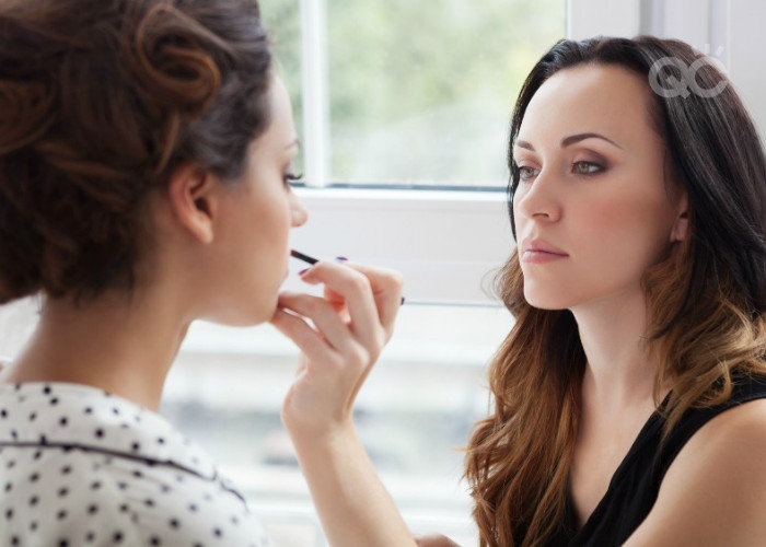 applying makeup on client