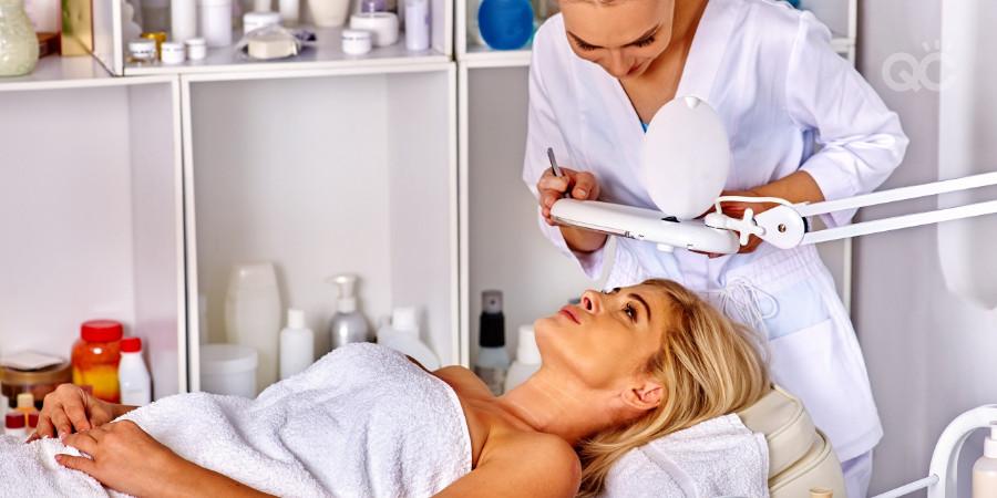 esthetician doing facial procedure on a client
