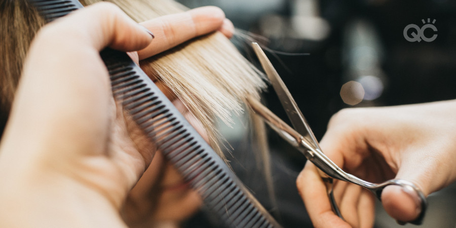 cosmetologist working with hair cutting and hair dressing