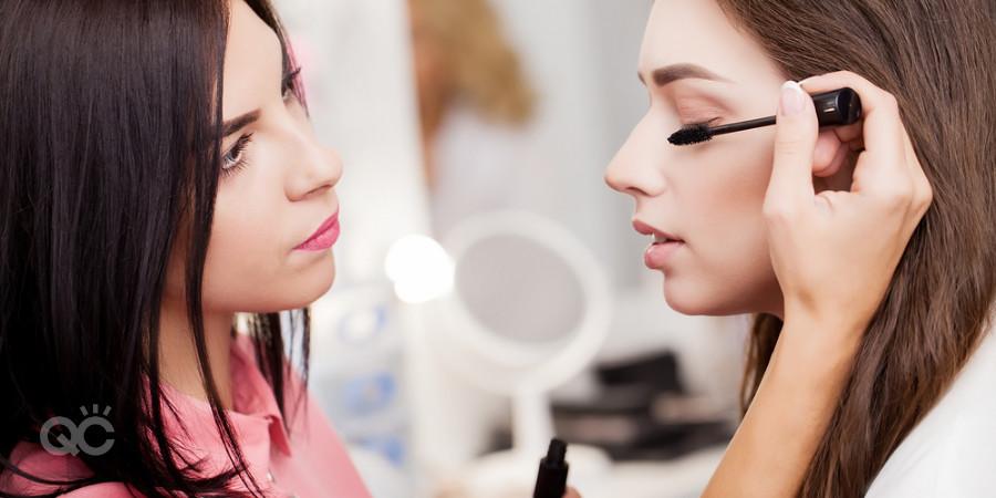 makeup artist applying mascara on client