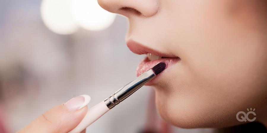 become a makeup artist applying lipstick