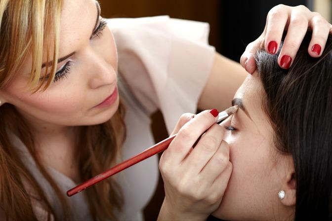 Makeup artist working on mature skin clients