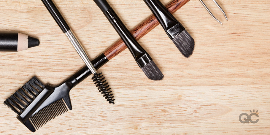 eyebrow products and tools in a makeup artist kit