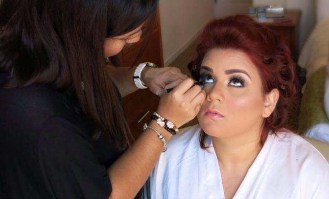 QC Makeup Academy student Nichole Carrasquillo working on bride