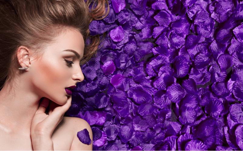model lying in purple rose petals
