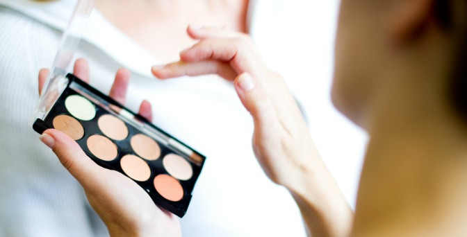 Makeup artist using corrector palette
