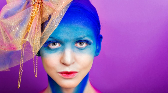 Model covered in blue airbrush makeup