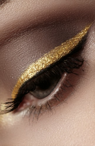 Gold eyeliner runway makeup