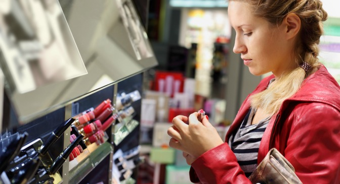 Customer looking at makeup in a store