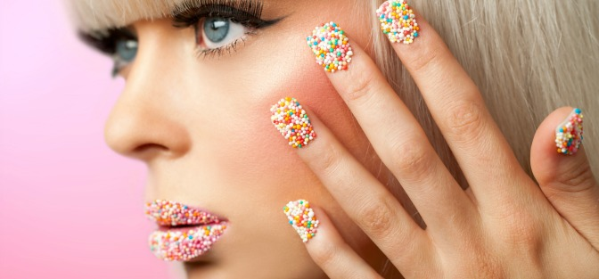 Girl with sprinkle-coated lips and manicure
