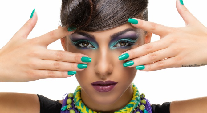 Woman with bright makeup posing for photo