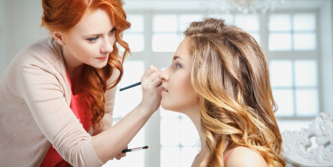 Makeup artist applying a client's makeup