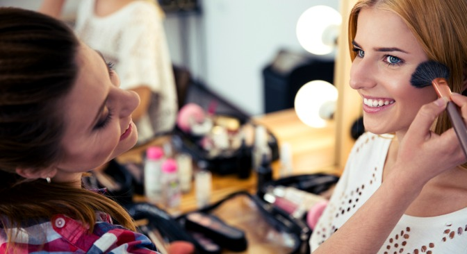 Makeup artist applying makeup to a client