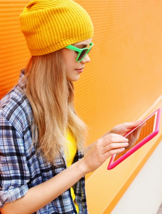 Girl using tablet against bright background