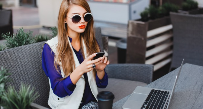 Girl using laptop and smartphone