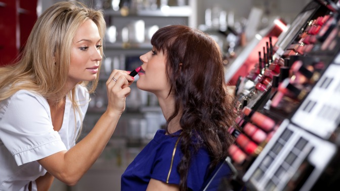 Makeup artist applying a client't makeup in store