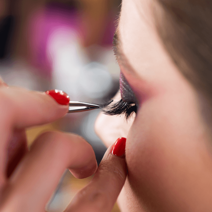 applying individual fake lashes for freelance makeup artistry