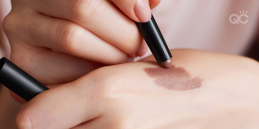 warming up a stick eyeshadow by applying it to the skin