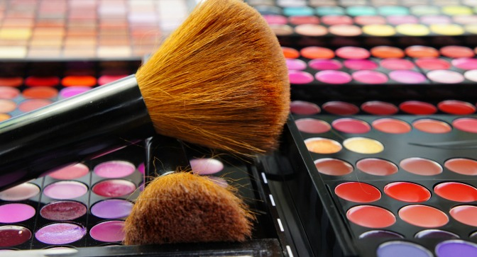 Makeup brushes on bright palettes