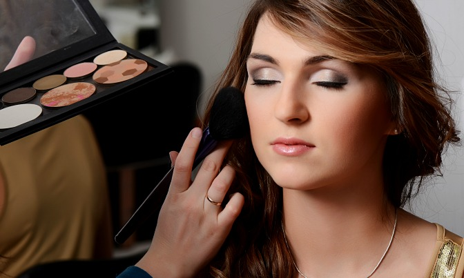 Makeup artist working on a client