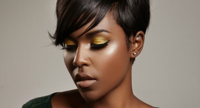 Dark skin tones with shimmery orange eye shadow