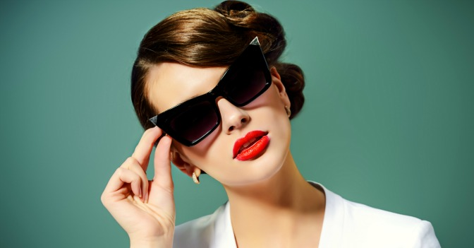 Woman wearing sunglasses and red lipstick