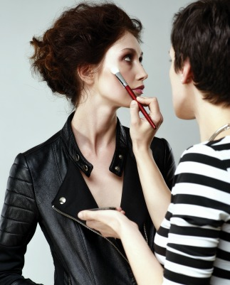 Runway makeup artist applying a model's makeup