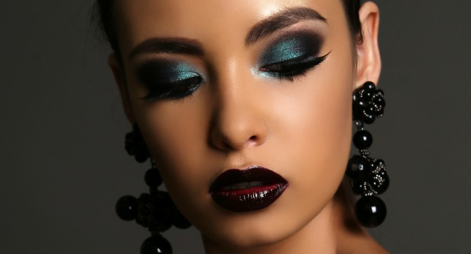 Dark skin with dramatic lip and blue smokey eye