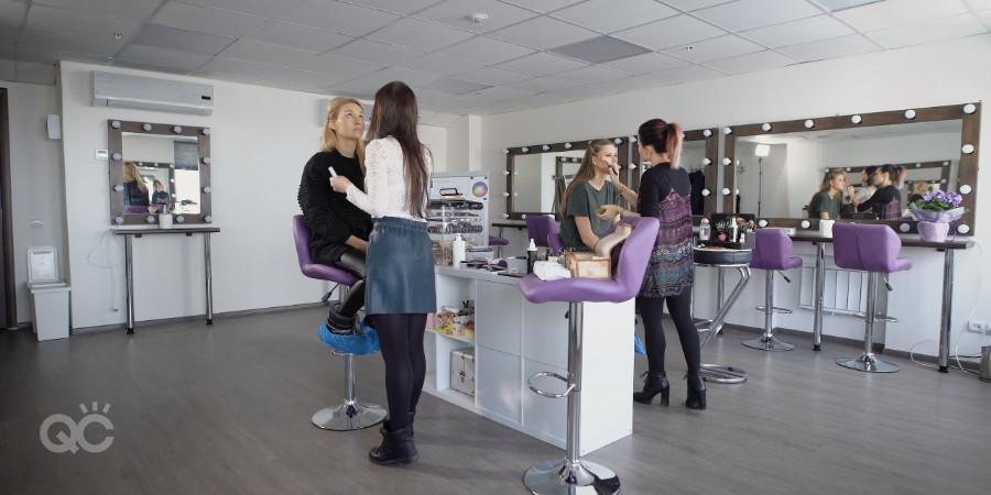 makeup assistant applying makeup with lead makeup artist at a professional makeup job
