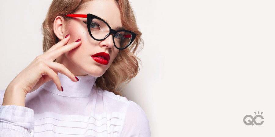 bold red lip with cat eye glasses frames
