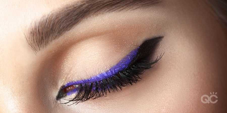 colored eyeliner and mascara to compliment glasses on makeup model