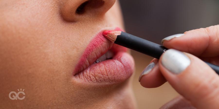 certified makeup artist applying lip liner
