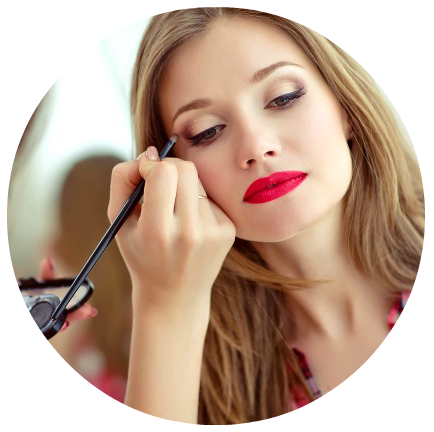 Professional makeup artist applying eyeshadow to client