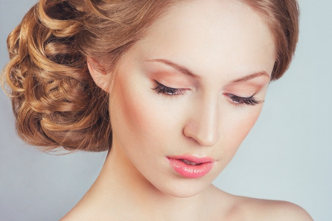 Creating contoured makeup look with airbrush machine