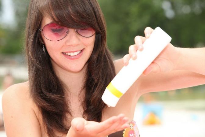 Makeup artist applying sunscreen to protect skin