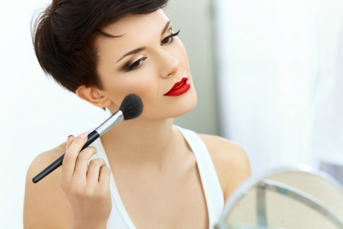 Woman learning professional makeup artistry online