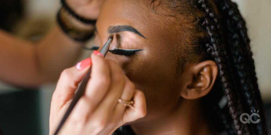 becoming a makeup artist applying makeup on model