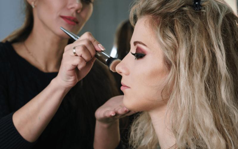 online makeup school student apply makeup on model