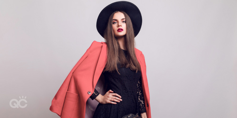girl with bold red lipstick, black outfit, and coral blazer for outfit balance and statement