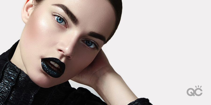girl with bold brows, reserved eye shadow, black lips, black outfit