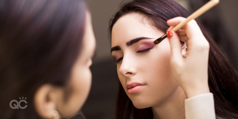 professional makeup artist applying makeup on client