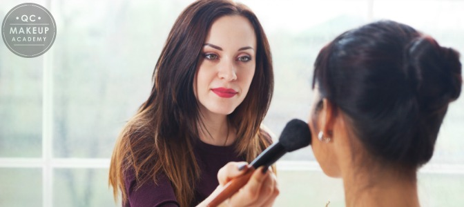 woman applying wedding makeup