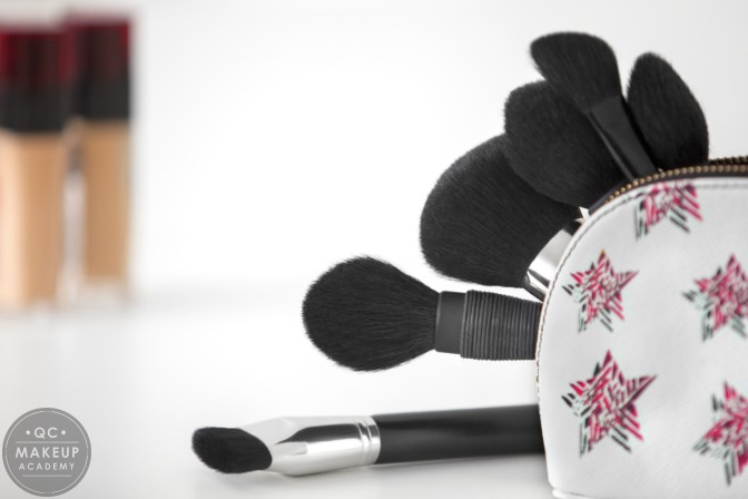 makeup kit with brushes and concealers