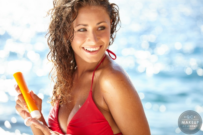 woman on beach with sunscreen and natural makeup